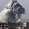 دخان يتصاعد بعد غارة على مدينة عين العرب