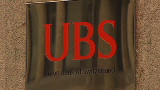 Troubled UBS picks itself up