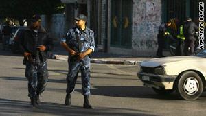 Hamas police patrol the streets of Gaza City on Thursday.