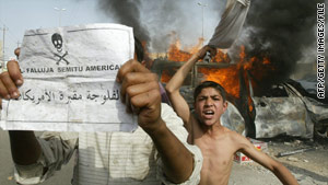 """Iraqis taunt U.S. forces with a leaflet reading, """"Falluja:  Cemetery for Americans"""" in March 2004."""