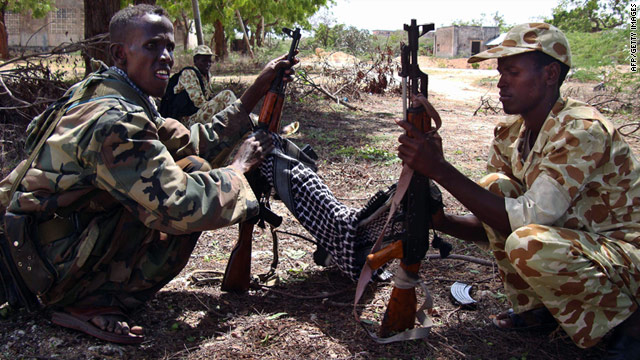 Somali government soldiers clean their weapons Thursday in Mogadishu, a city where a suicide attack killed two on Monday.