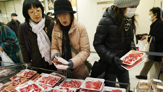 Japanese buy meat at a newly reopened department store in the city of Sendai on March 23, two weeks after the earthquake.