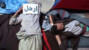 محتجون مناهضون للحكومة اليمنية خلال مظاهرة تدعو إلى الإطاحة بالرئيس علي عبد الله صالح بصنعاء في فبراير 2011