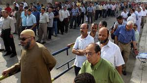 مصريون خارج مركز اقتراع بالقاهرة في يونيو 2012