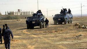أرشيف - قوات أمنية في مدينة معان خلال ملاحقة مطلوبين عام 2002