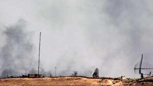 أرشيف - الدخان يتصاعد قرب مطار دير الزور خلال هجوم للثوار في 29 يونيو/ حزيران 2013