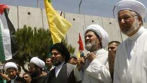 """شيوخ من السنة والشيعة يشاركون في مسيرة بجنوب لبنان في """"يوم القدس"""" الذي تحتفل به إيران سنويا، الصورة 2 أغسطس/ آب 2013"""