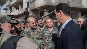 الأسد وسط قواته في الغوطة الشرقية: تغيرون ميزان العالم