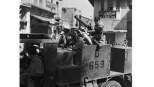 قوة من جبهة شرق الأردن، العربية، تجوب شوارع القدس عام 1938