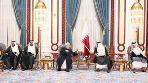 القرضاوي بجانب أمير قطر