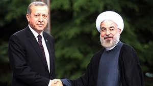 الرئيس التركي رجب طيب أردوغان مع الرئيس الإيراني حسن روحاني خلال زيارته الأخيرة لطهران 9 يونيو/ حزيران 2014