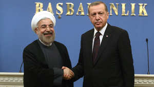 أرشيف- الرئيس التركي رجب طيب أردوغان مع الرئيس الإيراني حسن روحاني، في مؤتمر صحفي مشترك في أنقره خلال زيارة روحاني لتركيا 9 يونيو/ حزيران 2014