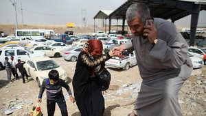 عائلات عراقية هربت من الموصل بعد سيطرة داعش