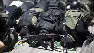أعضاء من كتائب عز الدين القسام، الجناح العسكري لحركة حماس