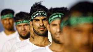 عراقيون شيعة يتلقون تدريبا عسكريا في النجف، 23 يونيو/ حزيران 2014