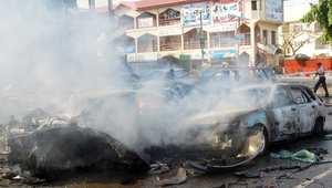 الدخان يتصاعد بعد انفجار قنبلة في مركز تسوق بالعاصمة النيجيرية 25 يونيو/ حزيران 2014