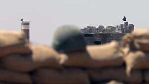 بنايات تسيطر عليها داعش كما تبدو من موقع لقوات البيشمرغة في سلمان باك
