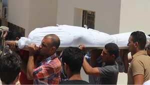 مصريون يشيعون جنازة رجل قتل في العريش على يد المليشيات المسلحة 14 يوليو/ تموز 2014