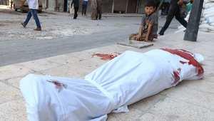 جثة في أحد شوارع مدينة حلب من ضحايا غارة للجيش الحكومي في 21 يوليو/ تموز 2014