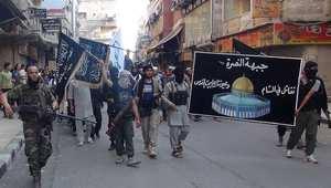 مسيرة لمقاتلي جبهة النصر في مخيم اليرموك جنوب دمشق 28 يوليو/ تموز 2014