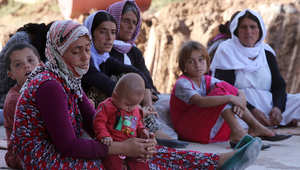 """أيزيديات في مدينة دهوك بعد فرارهن من جبل سنجار الذي احتله تنظيم """"داعش"""" 10 أغسطس/ أب 2014"""