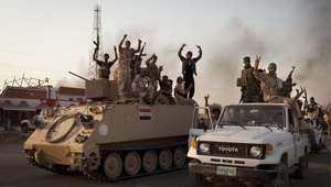 جنود عراقيون يلوحون بإشارات النصر بعد تحرير إمرلي من تنظيم داعش 1 سبتمبر/ أيلول 2014