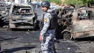 شرطي عراقي في موقع انفجار في بغداد الجديدة وقع في 10 سبتمبر/ أيلول 2014 واسفر عن مقتل 12 شخصا على الأقل