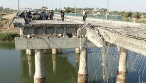 """جسر يفصل بين مقاتلي """"داعش"""" والبيشمرغة صورة التقطت في 14 أكتوبر/ تشرين الأول 2014"""