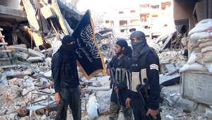 عناصر من جبهة النصرة في مخيم اليرموك بدمشق - أرشيف