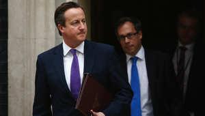 ديفيد كاميرون رئيس وزراء بريطانيا يغادر مكتبه للتوجه إلى البرلمان لمناقشة المشاركة أو عدم المشاركة في الغارات على داعش 26 سبتمبر/ أيلول 2014