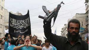 مؤيدون لجبهة النصرة في تظاهرة ضد بشار الأسد والتحالف الدولي في حلب 26 سبتمبر/ أيلول 2014