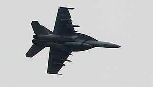 طائرة تابعة للتحالف الدولي في الحرب على داعش تحلق فوق كوباني في سوريا 19 اكتوبر/ تشرين الأول 2014