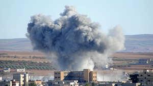 """أرشيف - غارة لطيران التحالف على مواقع في عين العرب """"كوباني"""" شمال سوريا 20 أكتوبر/ تشرين الأول 2014"""