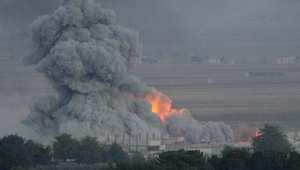 الدخان يتصاعد بعد غارة لطيران التحالف على كوباني 24 أكتوبر/ تشرين الأولي 2014