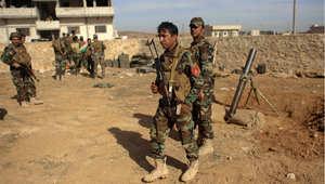 مقاتلون أكراد من البيشمرغة في كوباني