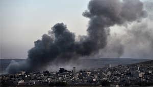 """أرشيف- غارة نفذتها طائرات التحالف بقيادة الولايات المتحدة على مدينة كوباني """"عين العرب"""" 9 نوفمبر/ تشرين الثاني 2014"""