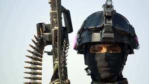 أحد مقاتلي القوات الخاصة العراقية في النجف قبل توجهه للمشاركة في الحرب على داعش