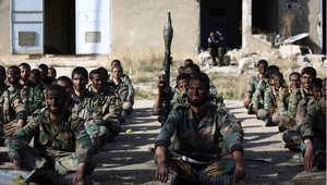 """عناصر من تنظيم """"جيش الإسلام"""" في الغوطة الشرقية خارج العاصمة دمشق"""