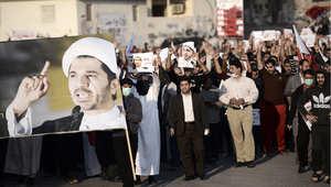 بحرينيون يتظاهرون للمطالبة بالافراج علن الشيخ علي سلمان رئيس جمعية الوفاق 1 يناير/ كانون الثاني 2014
