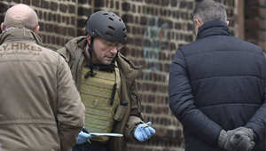 محققون جنائيون في موقع الغارة على خلية إرهابية في مدينة فيرفيه شرق بلجيكا 16 يناير/ كانون الثاني 2015