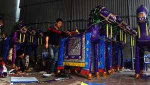 بالصور.. أحصنة من ورق للنذور..وليمتطيها الأموات بعد وفاتهم بفيتنام