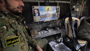 عنصر بقوة الأمن الوطني السوري الموالية لبشار الأسد