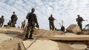 """أرشيف - متطوعون من المقاتلين الشيعة موالون للحكومة العراقية في الحرب على """"داعش"""" في قرية الفضيلية 24 فبراير/ شباط 2015"""