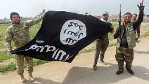 """عناصر مليشيا عراقية شيعية بعد استيلائهم على مواقع كان يسيطر عليها تنظيم """"داعش"""" قرب تكريت، 9 مارس/ آذار 2015"""