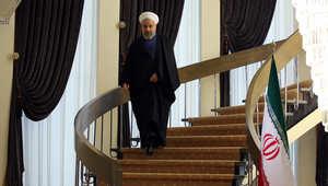 الرئيس الايراني حسن روحاني يصل للتحدث خلال مؤتمر صحفي في طهران