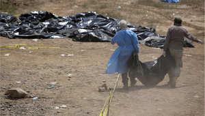 أرشيف- العثور على مقابر جماعية في تكريت 12 أبريل/ نيسان 2015