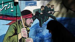 صورة لجنود إيرانيين أثناء الحرب العراقية الإيرانية في ساحة فلسطين بطهران، بعد مظاهرة للتنديد بضربات التحالف الذي تقوده السعودية ضد الحوثيين باليمن