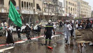 عراقيون في موقع التفجير الذي استهدف تجمعا للشيعة في بغداد يحضرون للاحتفال بذكرى الإمام موسى الكاظم، 9 مايو/ أيار 2015