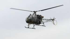 المروحية العسكرية النيبالية التي حدد طاقمها موقع تحطم المروحية الأمريكية خلال تحليقها في قاعدة بكاتماندو 15 مايو/ أيار 2015