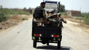 قوات من الحشد الشعبي في عربة خفيفة في منطقة الكرمة بمحافظة الأنبار غرب بغداد، 19 مايو/ أيار 2015